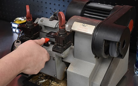 image of a key cutting machine in action