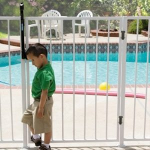 child standing outside of pool gate lock