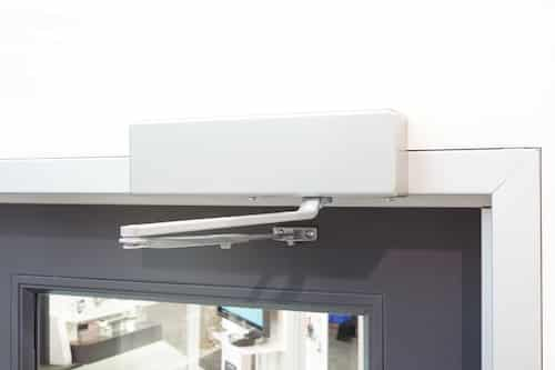 parallel arm door closer installed on commercial door